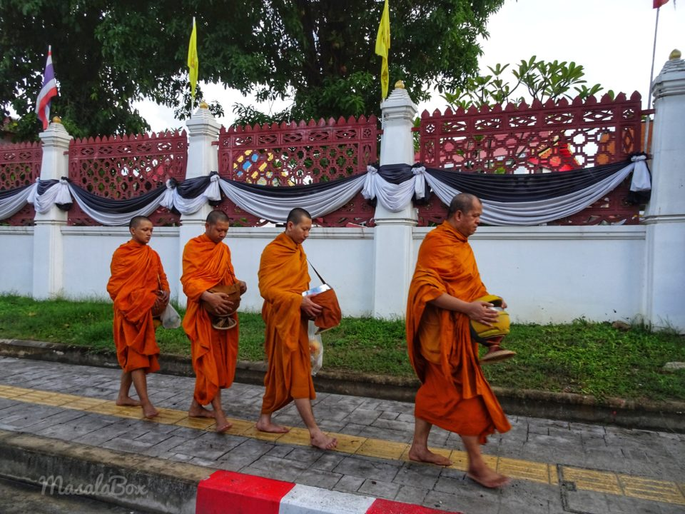 How to give Alms to Buddhist Monks – Old Phuket Town, Thailand